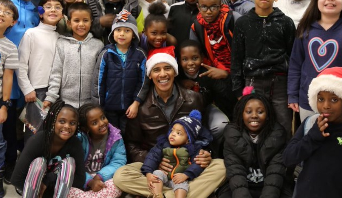 Obama Rocks A Santa Hat During Surprise Christmas Visit To The Boys & Girls Club In DC